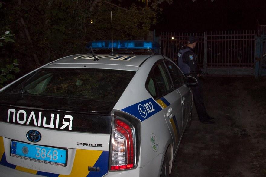 В Днепре неизвестные с оружием хотели захватить парковку (фото)
